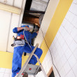 Construction worker on a ladder — Stock Photo #14038536