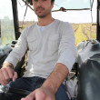 Stock Photo: Msitting in tractor Dubroca_Joffrey_140410