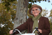 Old lady on a bike ride — Stock Photo