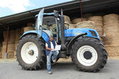 Farmer with his tractor — Stock Photo