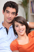 Young couple sitting in their front room — Stock Photo