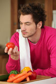 Young man preparing vegetables — Stock Photo