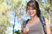 Young female trekker checking her compass — Stock Photo