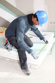 Man measuring insulation boards — Stock Photo