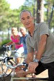 Portrait of a man on a bike — Stock Photo