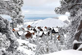Snow covered chalets — Stock Photo