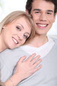 Woman hugging her boyfriend — Stock Photo