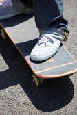 Close-up of kid on skateboard — Stock Photo