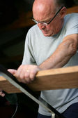 Senior carpenter — Stock Photo
