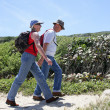 Couple hiking along the coast — Stock Photo #14040010