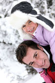 Father and daughter in the snow — Stock Photo