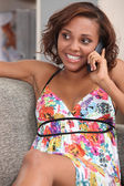 Young brunette on the phone — Stockfoto