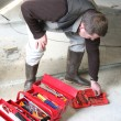 Stock Photo: Worker looking for tool in his toolbox