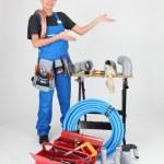 Woman plumber showing — Stock Photo
