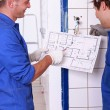 Stock Photo: Electricians with installation plan