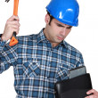 Tradesman hitting his laptop — Stock Photo