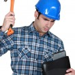Tradesman hitting his laptop — Stock Photo #14097478