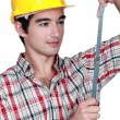Stock Photo: Carpenter with specialist rule