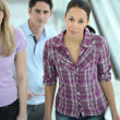 Woman and colleagues walking indoors — Stock Photo