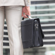 Closeup of mcarrying briefcase — Stock Photo #14099552