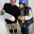 Electrician and apprentice — Stock Photo