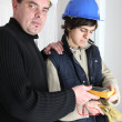 Workers using a multimeter - Foto Stock