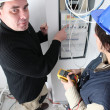 Royalty-Free Stock Photo: Electricians at a fusebox