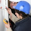 Stock Photo: Worker using multimeter