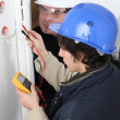 Worker using a multimeter — Stock Photo