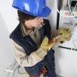 Stock Photo: Young mrepairing distribution board