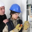 Twosome of electricians: trainer and apprentice — Stock Photo