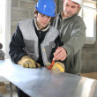 Stock Photo: Craftsmand apprentice working together