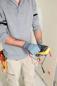 Electrician using multimeter — Stock Photo