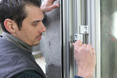 Man fitting a window — Stock Photo