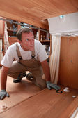 Plumber under a sink — Stock Photo