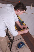 Man taking measurements on a workbench — Stock Photo