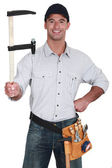 Man holding a clamp — Stock Photo