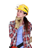 A pensive tradeswoman — Stock Photo