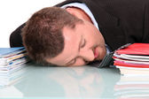 Exhausted man at work — Stock Photo