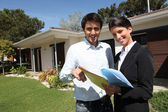 Young man and a real estate agent — Stock Photo