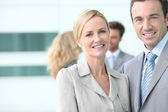 Smiling executives outside offices — Stock Photo