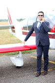 Businessman with a light aircraft — Stock Photo