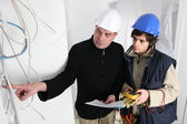 Electrician and his apprentice — Stock Photo