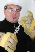 Electrician clipping wire — Stock Photo