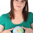 Teenager with a mini globe Godreau_Lea_140410 — Stock Photo #14100100