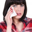 Woman wiping away a tear — Stock Photo