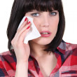 Stock Photo: Womwiping away tear