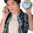 Teen communicating with globe — Stock Photo