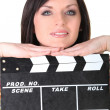 Woman with a clapperboard — Stock Photo