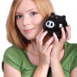 Young woman with money box — Stockfoto